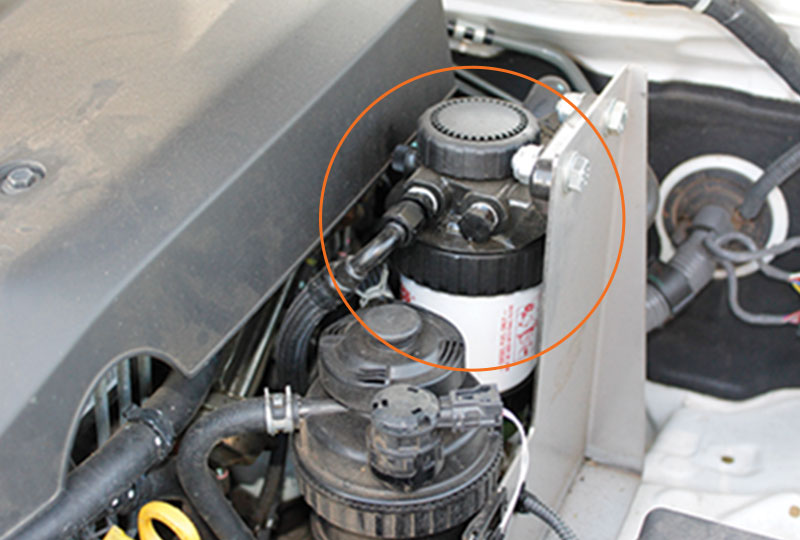 Fuel Manager pre-filter unit in engine bay, Diesel Engine Protection Kits, Direction Plus ProVent systems, Power Curve Performance.