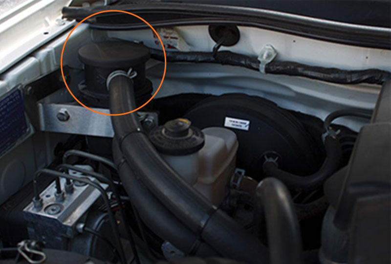 Closeup of ProVent oil separator catch can in engine bay